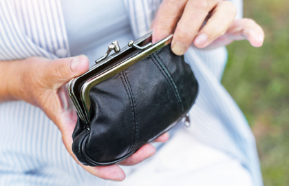 photo of woman's hands holding purse